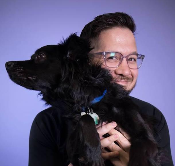 Nick Pappas holding a black dog