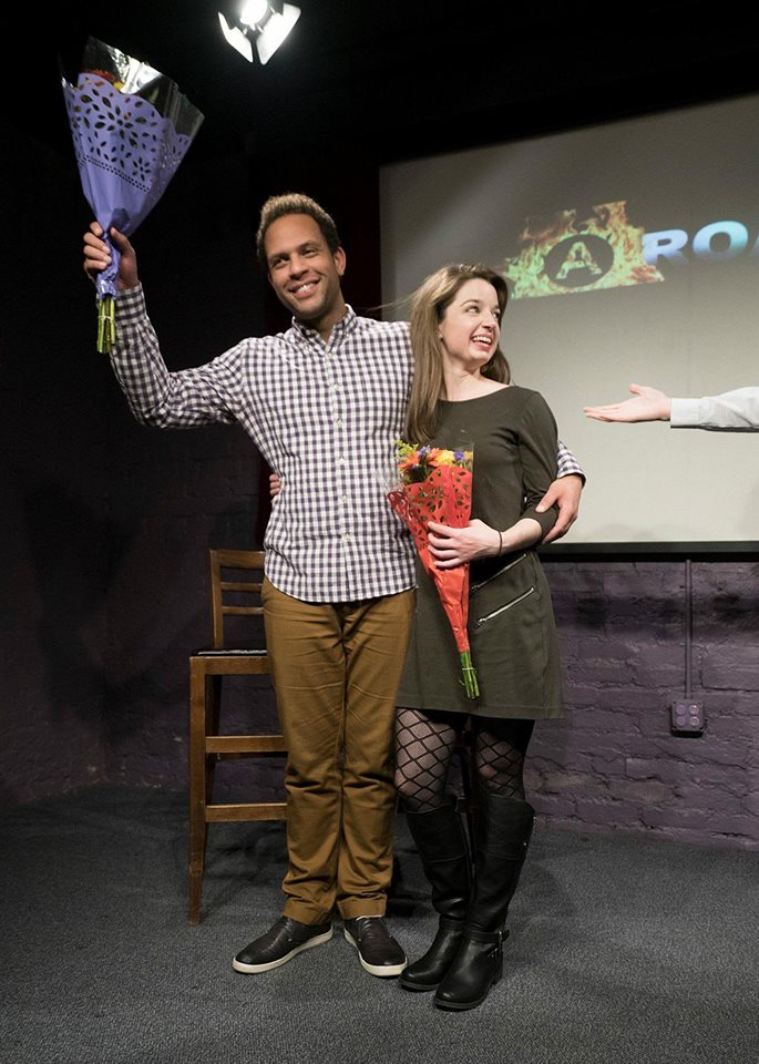 Jason Farr and Justina Sparling holding bouquets at Alchemy Theater.